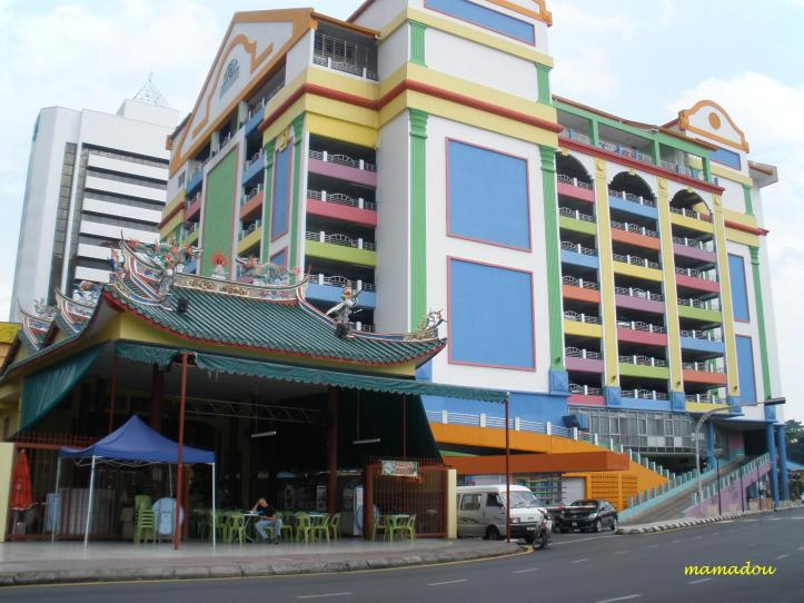 Kuching - Old Temple and Colourful Modern Building